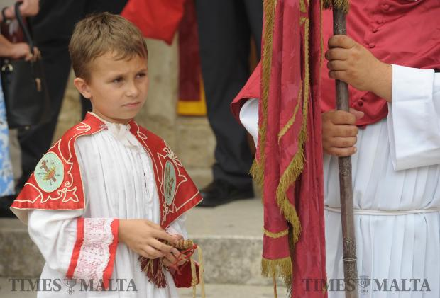A boy takes part in the Corpus Christi procession at St Paul's Church in Rabat on June 18. Photo: Matthew Mirabelli