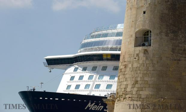 A cruise liner towers alongside the bastions in Valletta on August 9. Photo: Matthew Mirabelli