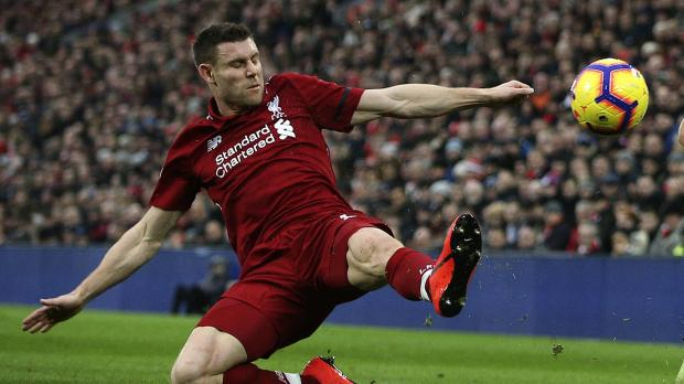 James Milner did not wait for a telling off from 'Mr Moss'. Photo: AFP