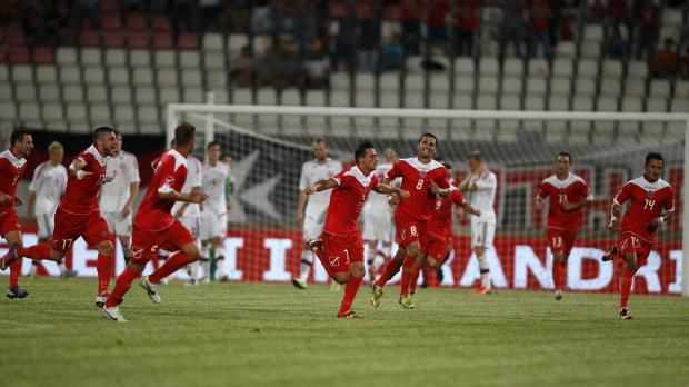 Clayton Failla (C) celebrates his goal against Denmark during their 2014 World Cup qualifying soccer match at the National Stadium in Ta' Qali. Photo: Darrin Zammit Lupi