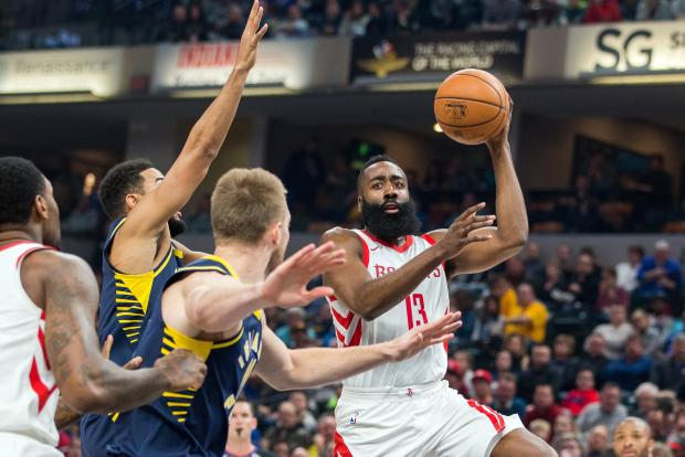 Houston Rockets guard James Harden (13) passes the ball while Indiana Pacers players defend in the first half of the game at Bankers Life Fieldhouse. Photo: Trevor Ruszkowski-USA TODAY Sports