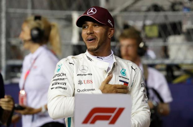Lewis Hamilton will start on pole for Sunday's Singapore GP.