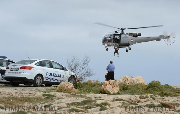 An AFM helicopter takes part in a rescue operation together with members from the Civil Protection Department and the Police Force at l-Aħrax tal-Mellieħa on April 17. Photo: Matthew Mirabelli