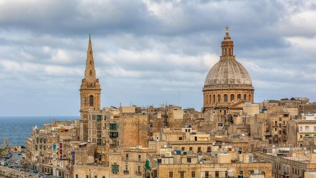 The spire of St Paul's pro-cathedral (left) and the the Carmelite church in Valletta.