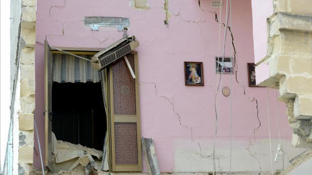 Framed pictures survived the apartment block collapse in Gwardamanġa in April