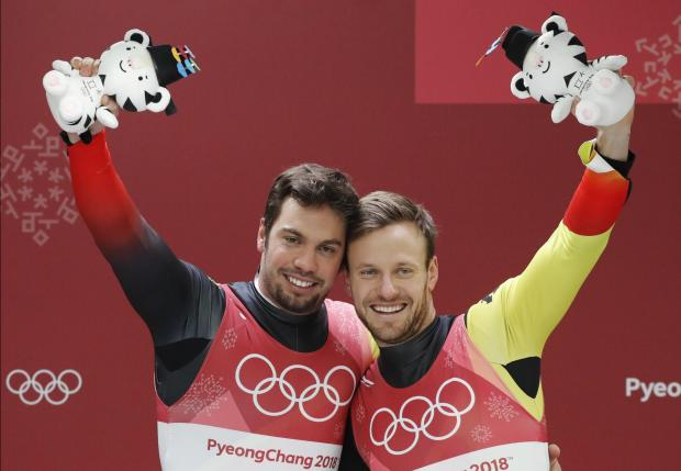 Tobias Wendl and Tobias Arlt of Germany celebrate winning gold.