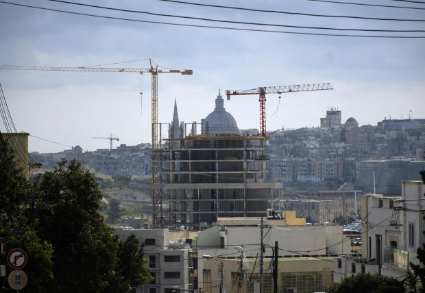 A building being built covers the view of the Anglican church in Valletta seen from Kappara on April 4. PHOTO: MARK ZAMMIT CORDINA.