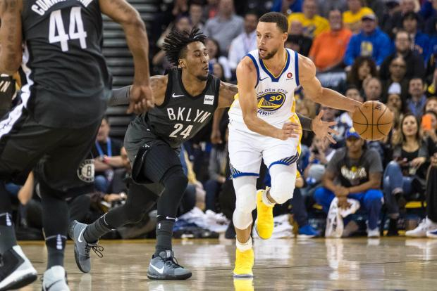 Golden State Warriors guard Stephen Curry (30) dribbles as Brooklyn Nets forward Rondae Hollis-Jefferson (24) defends in the first quarter at Oracle Arena. Photo Credit: John Hefti-USA TODAY Sports