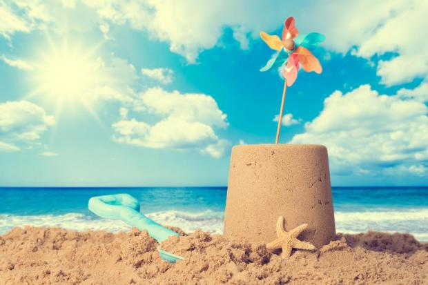 Louts kicked over the child's sand castle. Photo: Shutterstock