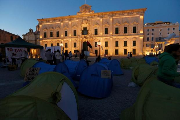 Environmental activists stand near their tents in a camp they set up to protest against what they say is over-development throughout the Maltese islands, in front of the Auberge de Castille housing the Office of the Prime Minister in Valletta on May 14. Photo: Darrin Zammit Lupi