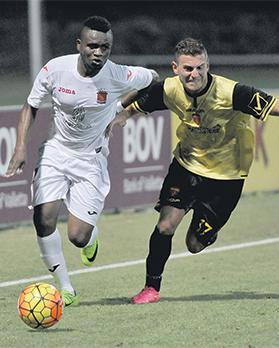 Valletta's Uchenna Umeh (left) charges forward against Folgore during last week's first leg.