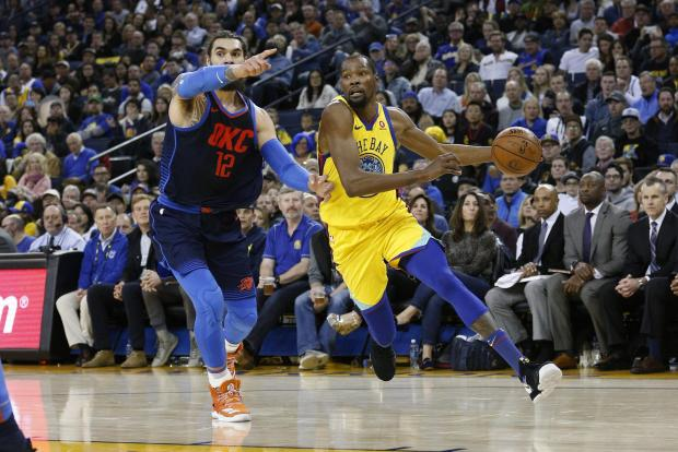 Golden State Warriors forward Kevin Durant (35) drives past Oklahoma City Thunder center Steven Adams (12) in the third quarter at Oracle Arena. Photo Credit: Cary Edmondson-USA TODAY Sports