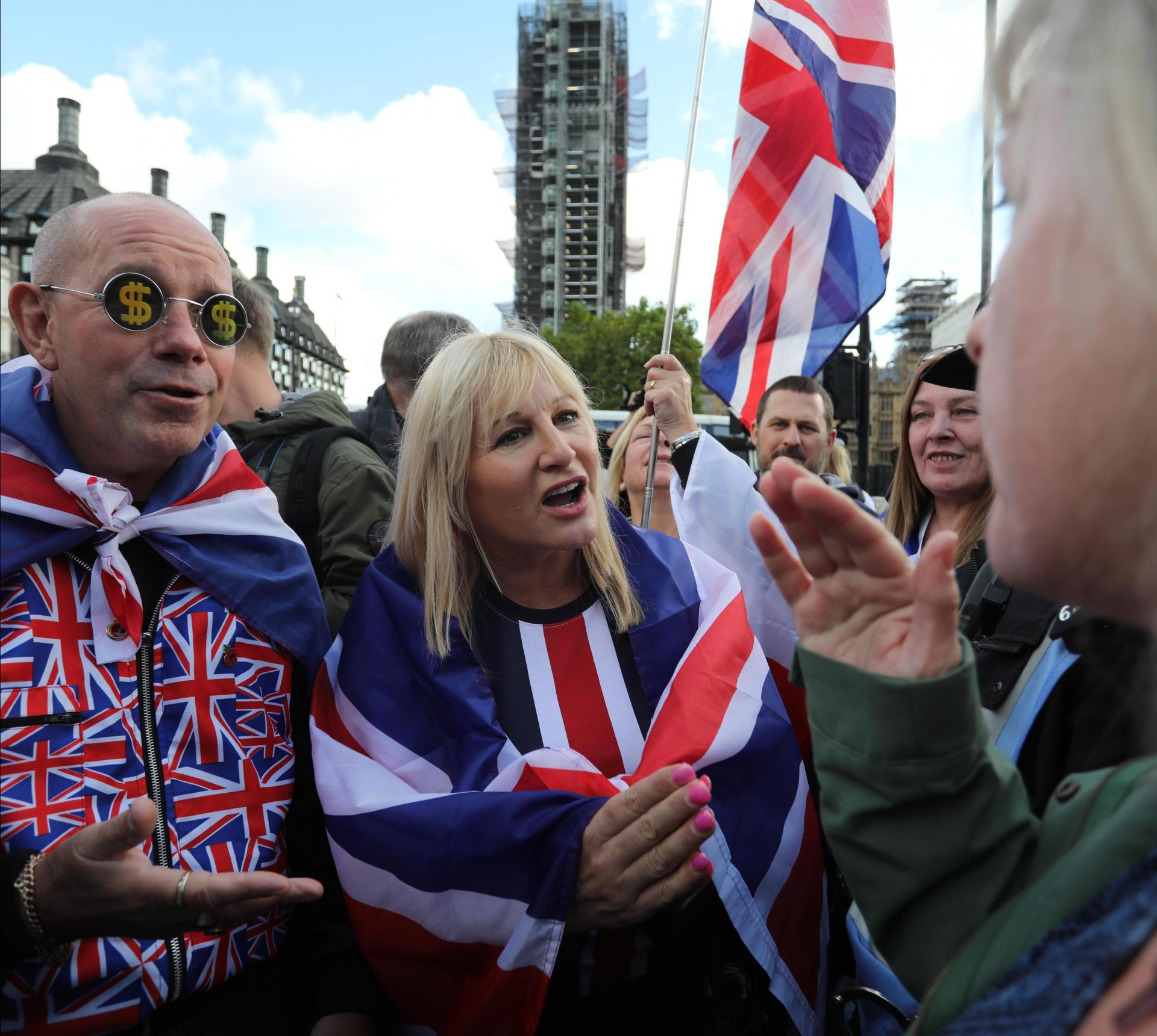 Pro-Brexit demonstrators speak with anti-Brexit demonstrators in Parliament Square in central London. Photo: AFP
