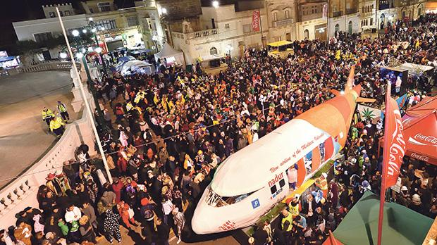 The inclement weather did little to keep the crowd of carnival revellers away from Nadur.