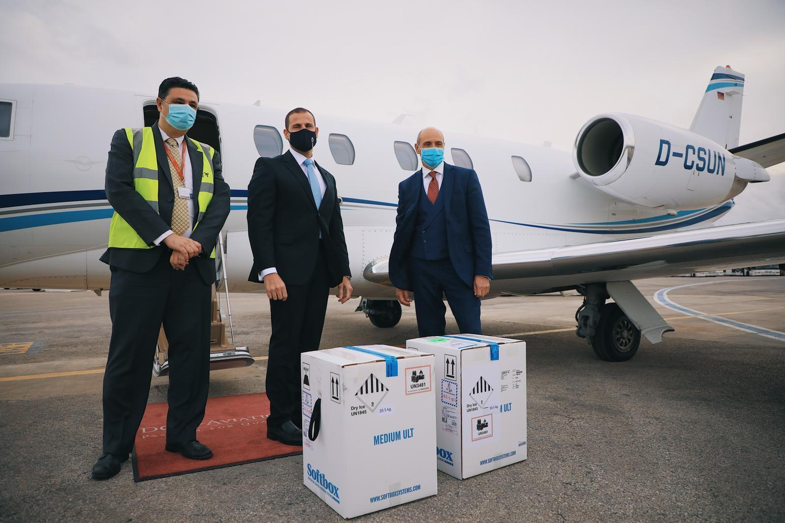Prime Minister Robert Abela (centre) and Health Minister Chris Fearne (right) stand behind boxes of the vaccine. Photo: DOI