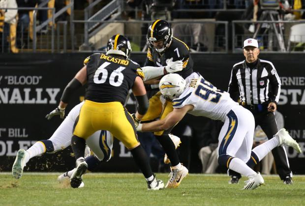 Los Angeles Chargers defensive tackle Justin Jones (hidden) and defensive end Joey Bosa (99) combine on a sack of Pittsburgh Steelers quarterback Ben Roethlisberger (7) during the third quarter at Heinz Field. The Chargers won 33-30. Mandatory Credit: Charles LeClaire-USA TODAY Sports