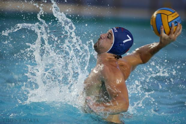 Neptunes' Steve Camilleri scores his third goal during his side's 9-7 victory over San Giljan during their waterpolo league decider at the National Pool on September 3. Photo: Darrin Zammit Lupi