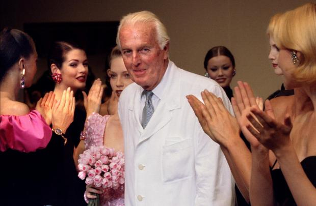 French fashion designer Hubert de Givenchy is applauded by the models after he presented his last High Fashion collection Autumn/Winter 1995.