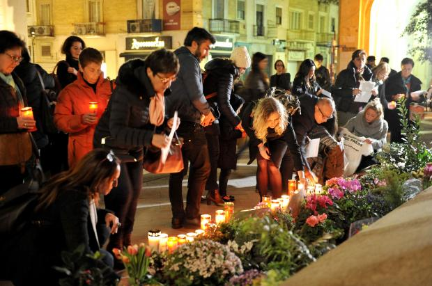 People lay flowers and candles at the Daphne Caruana Galizia Memorial in Valletta to mark the tenth anniversary of her blog on March 2. Photo: Chris Sant Fournier