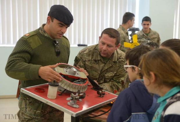 Armed Forces of Malta soldiers interact with students at the NSTF Science Fair at the Mcast campus in Paola on March 11. Photo: Matthew Mirabelli