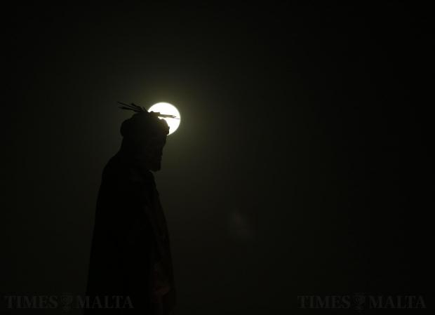 The full moon rises behind a statue depicting Jesus Christ on the hill leading up to Laferla Cross outside Siggiewi on March 24. Every year on Maundy Thursday, thousands of religious devotees make their way up the hill, the highest point on the Maltese islands, on a Seven Churches Visitation pilgrimage as part of Holy Week activities before Easter. Photo: Darrin Zammit Lupi