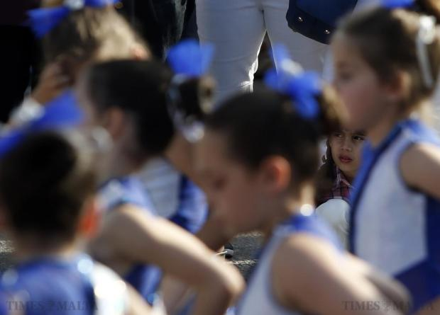 A child watches dancers performing during the Potato and Agrarian Festival at Gnien il-Warda in Qrendi on May 31. Photo: Darrin Zammit Lupi