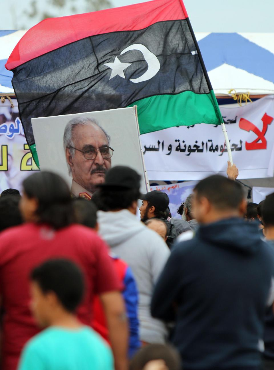 A Libyan demonstrator holds an image of General Khalifa Haftar. Photo: AFP