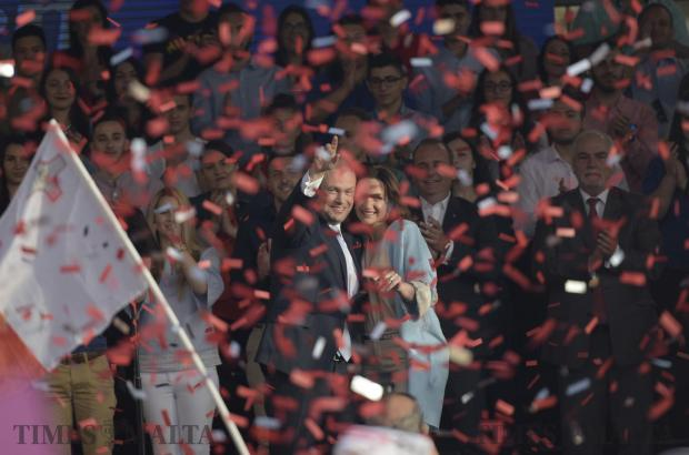 Prime Minister Joseph Muscat and his wife Michelle wave to the crowd whilst red confetti is shot into the air, moments after ending his speech during a meeting held by the Labour party in Zabbar on May 7. Photo: Mark Zammit Cordina
