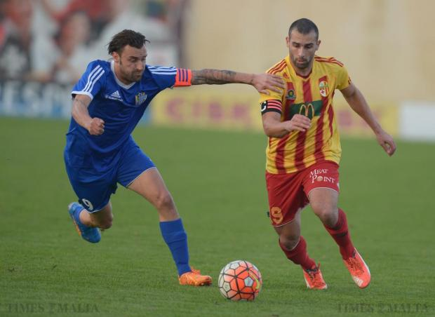 Mosta's Manolito Micallef and Birkirkara's Joseph Zerafa compete for the ball during their Premiership league match at the Hibernians stadium in Paola on December 19. Photo: Matthew Mirabelli