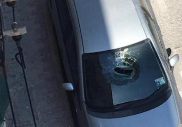 Falling stone crashes through parked car's windscreen