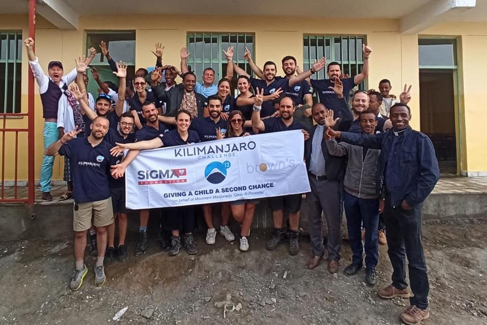 Trekkers and organisers from the Kilimanjaro Challenge celebrate the opening of the new primary school. Picture: Kilimanjaro Challenge Malta/ Facebook