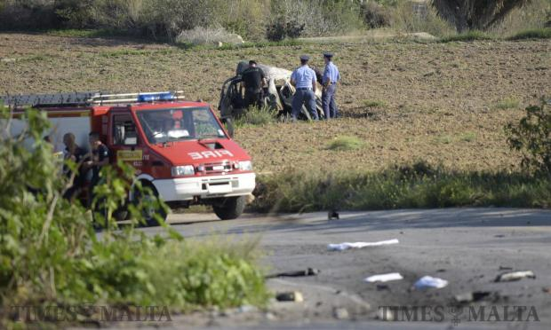 Police officers look through the wreckage of the car where journalist Daphne Caruana Galizia was murdered brutally by a car bomb on October 16. Photo: Mark Zammit Cordina