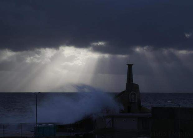 A wave breaks against the quay in Cirkewwa on March 27. Photo: Darrin Zammit Lupi