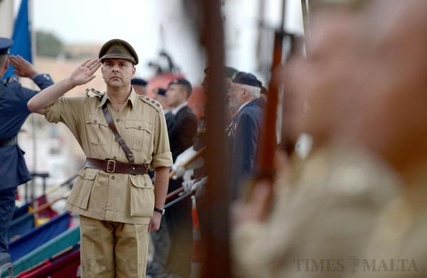 A re-enactor salutes during a commemoration ceremony for Operation Pedestal – the do-or-die attempt by a convoy of 13 freighters and a tanker to deliver supplies to starving Malta and Gozo – the Santa Marija convoy, at Ta' Liesse, Valletta on August 11. The convoy had been escorted by the most powerful fleet assembled for any single supply convoy operation of World War II. Only five ships reached Malta after a fierce battle along the route from near Gibraltar to Malta. Photo: Matthew Mirabelli