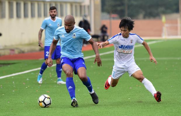 Sliema striker Jefferson (left) defends possession from Kei Hirose. Photo: Mark Zammit Cordina