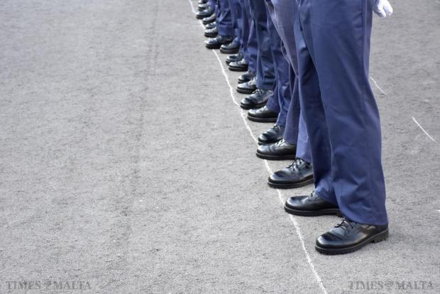 Newly graduating police officers stand in a line on the parade grounds during their graduation ceremony at the police academy in Mqabba on September 29. Photo: Mark Zammit Cordina