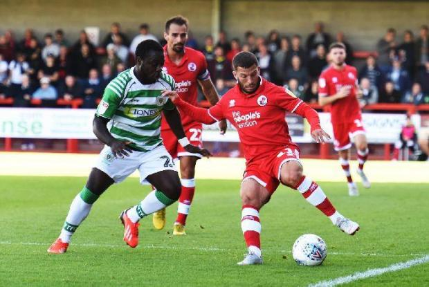 Luke Gambin (right) in action for Crawley Town.