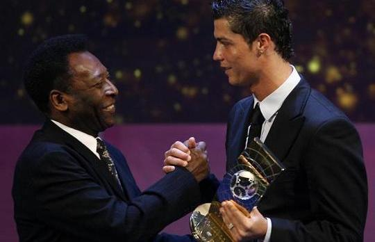 Cristiano Ronaldo is congratulated by Pele.