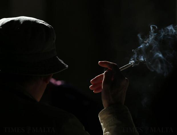 A tourist smokes a cigarette at an outdoor cafe in Valletta on November 13. Photo: Darrin Zammit Lupi