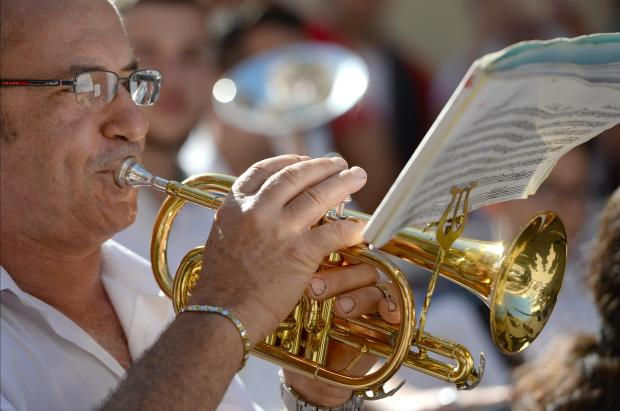 A man plays a trumpet at the opening ceremony of the Medigames in Bugibba on June 17. Photo: Matthew Mirabelli