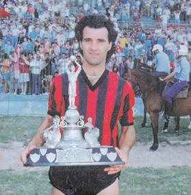 Ħamrun star player Raymond Vella holding the FA Trophy.