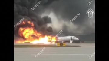 Russia probes pilot error after deadly plane blaze