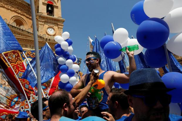 Revellers take part in a village band march during celebrations marking the feast of the Assumption of Our Lady in Mosta on August 15. Photo: Darrin Zammit Lupi