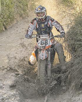 Muddy terrain... Peter Sammut rides his KTM bike.