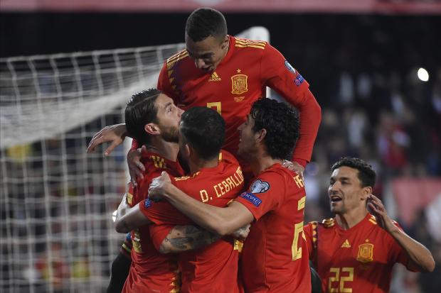 Spain player mob Sergio Ramos after he scored the winner against Norway.