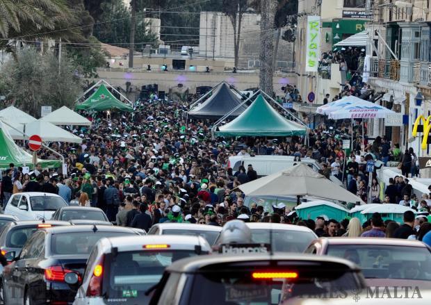 A large crowd gathers in Spinola Bay, St Julian's to celebrate St Patrick's day on 17 March. Photo: Steve Zammit Lupi