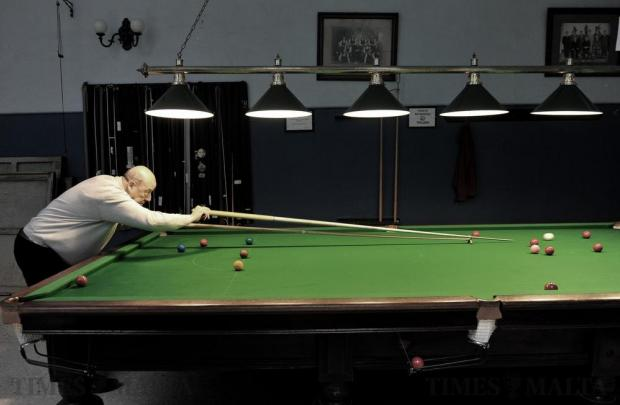 A snooker player takes a shot at the La Vallette Band Club in Valletta on December 30. Photo: Chris Sant Fournier