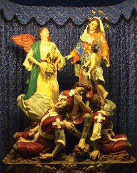 Our Lady of Liesse with Child, the angel and the three knights, a 1981 papier-mache sculpture by Albert Micallef plated in 18-carat gold and oil painted.