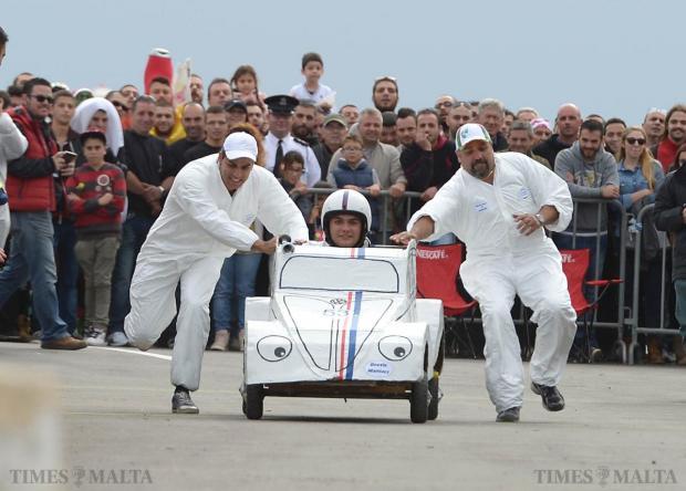 Participants push a soapbox car during Paqpaqli Ghall-Istrina car show at Hal Farrug on December 7. Photo: Matthew Mirabelli