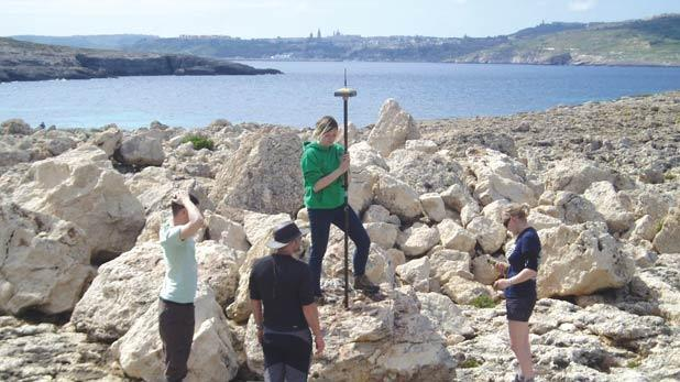 Scientists investigating evidence of tsunami damage on Comino in 2014.